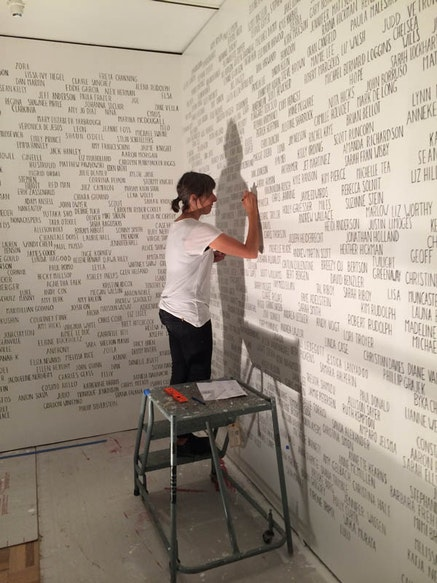 Amanda Eicher at work on <em>Genealogy</em> (2014) for the exhibition <em> Fertile Ground: Art and Community in California</em>, Oakland Museum of California. Photo by Scott Moulton.