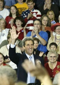 John Kerry is welcomed by the crowd gathered for a discussion about strengthening the middle class during a visit to Tipton, Iowa. Photograph by Kerry-Edwards 2004, Inc. from Sharon Farmer.