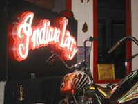 A few of Indian Larry's handmade motorcycles in his shop.