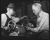 Two grandfathers, both seventy, work in an Eastern shipyard, 1942. The yard kept up production by bringing many older workers out of retirement. Library of Congress Prints & Photographs Division.