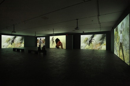Janet Biggs, <em>A Step On the Sun</em>, 2012. (installation view) multi-channel, high definition video installation with sound. Courtesy the artist, Cristin Tierney Gallery, New York, Analix Forever, Geneva, and CONNERSMITH, Washington, D.C.