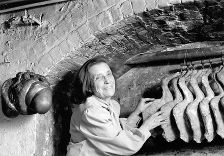 Louise Bourgeois with <em>Janus Fleuri</em> (1968) and elements from <em>The Destruction of the Father</em> (1974) in her NYC home in 1977. Photo: Blaine Waller. © The Easton Foundation/Licensed by VAGA, New York.
