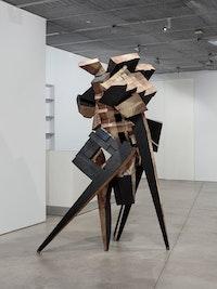 <p>Mel Kendrick, <em>Sculpture No. 4</em>, 1991. Poplar, steel, lampblack, and linseed oil, 108 x 57 x 53 inches.</p>