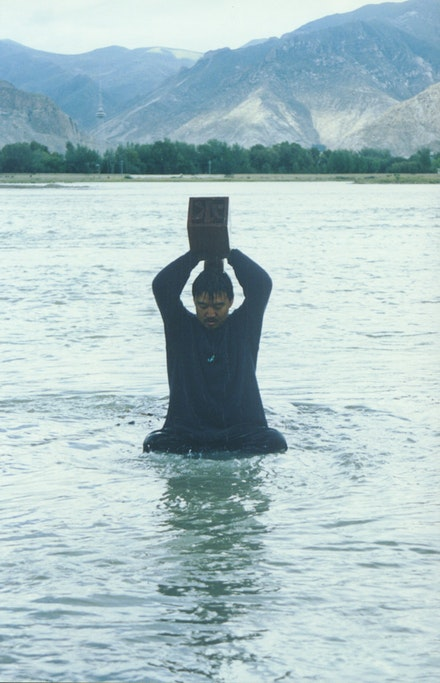 Song Dong, <em>Stamping the Water, </em>1996. 36 chromogenic prints, 61 x 40 centimeters each. Courtesy the Metropolitan Museum of Art, New York. Promised Gift of Cynthia Hazen Polsky.
