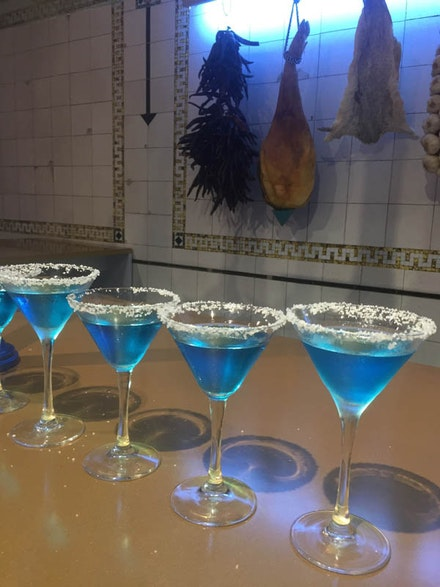 <p>Detail of <em>El Internacional Tapas Bar & Restaurant</em> featuring the signature blue margarita cocktail (Photo: Kathy Brew).</p>