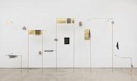 Ishmael Randall Weeks, <em>Wind Variations</em>, 2017. Eroded 1960s bricks, brass, phototransfers on gel. 78 x 180 x 20 inches. Courtesy Van Doren Waxter.