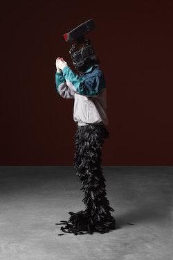 <p>Minouk Lim,<em> L'homme &agrave; la cam&eacute;ra</em>, 2015. FRP mannequin, windbreaker, gloves, feathers, broadcast camera 88.58 x 26.77 x 22.83 inches. Courtesy Tina Kim</p>