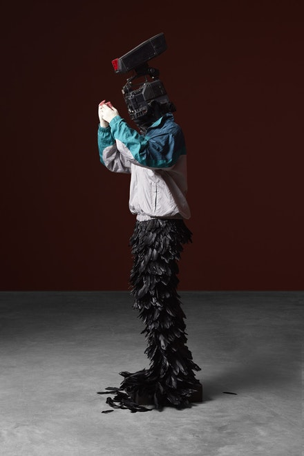 <p>Minouk Lim,<em> L'homme à la caméra</em>, 2015. FRP mannequin, windbreaker, gloves, feathers, broadcast camera 88.58 x 26.77 x 22.83 inches. Courtesy Tina Kim</p>