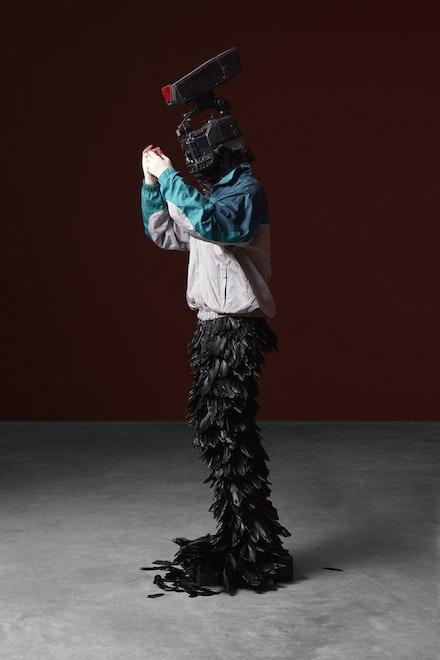 <p>Minouk Lim,<em> L'homme à la caméra</em>, 2015. FRP mannequin, windbreaker, gloves, feathers, broadcast camera 88.58 x 26.77 x 22.83 inches. Courtesy Tina Kim</p>