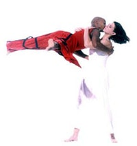 Jane Comfort and Company's PERSEPHONE; Cynthia Bueschel Svigals as Persephone (in white) and Olase Freeman as Hades (in red). Photo by Arthur Elgort.
