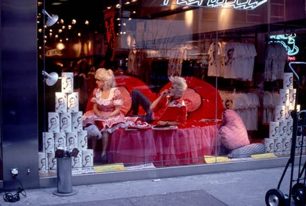 <p><em>Valentine&rsquo;s Day Repose</em>, 1982. Photograph by April Palmieri. Pictured: Katy K and John Sex in the window of Fiorucci. Courtesy the artist.</p>