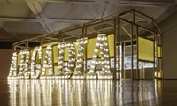 <p>Ellen Harvey, <em>Arcade/Arcadia</em>, (2011-2012), Wood frame, aluminum letters, light bulbs, and 34 hand-engraved Plexiglass mirrors over Lumisheets. Courtesy the artist and Danese/Corey.</p>