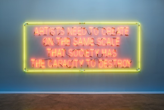 Lauren Bon, <em>Artists Need to Create on the Same Scale That Society Has the Capacity to Destroy</em>, 2017. Neon, 6 x 14 1/2 feet. This sign illuminates a quote by Sherrie Rabinowitz which connects deeply to the formation of the Metabolic Studio. Photo: Zack Garlitos.