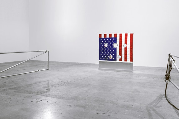 Cady Noland, <em>Gibbet</em>, 1993-1994, aluminum, wood, fabric, stocks: 60 1/4 x 56 1/4 x 8 in (153 x 142.9 x 20.3 cm), stool: 21 x 21 x 11 1/2 in (53.3 x 53.3 x 29.2 cm), © 2017 Cady Noland. Courtesy Venus Over Manhattan, New York.