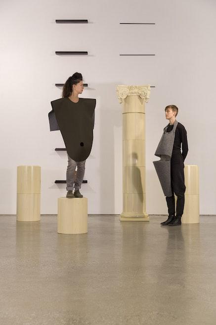 Caroline Woolard, <i>DIY Ruin</i>, installation view with costuming by Lika Volkova, at 41 Cooper Gallery, New York, 2016-2018, turned poplar, oil paint pickling, felt, website, 18
