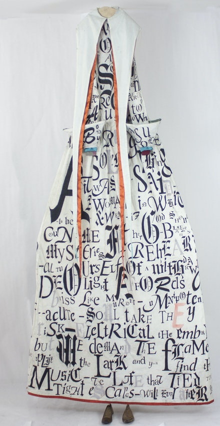 Lesley Dill,<em> Omnipotence Enough,</em>, 2018. Oil Stick on Fabric, 97 inches x 22 inches. Courtesy of the artist.