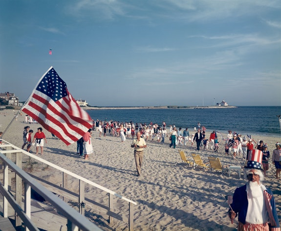 Tina Barney, <em>4th of July on Beach</em>, 1989. Chromogenic color print. 30 x 40 inches. Edition of 5. © Tina Barney. Courtesy Paul Kasmin Gallery.