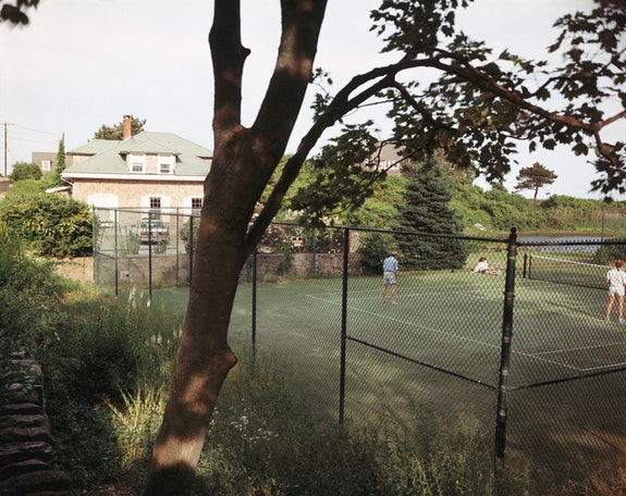Tina Barney, <em>Tennis Court</em>, 1988. Chromogenic color print. 20 x 24 inches Edition of 5. © Tina Barney, Courtesy Paul Kasmin.