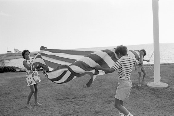Tina Barney, <em>The Flag</em>, 1977. © Tina Barney. Image Courtesy of Tina Barney and Paul Kasmin Gallery.