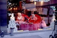 Valentine's Day Repose, 1982. Photograph by April Palmieri. Pictured: Katy K and John Sex in the window of Fiorucci. Courtesy the artist.