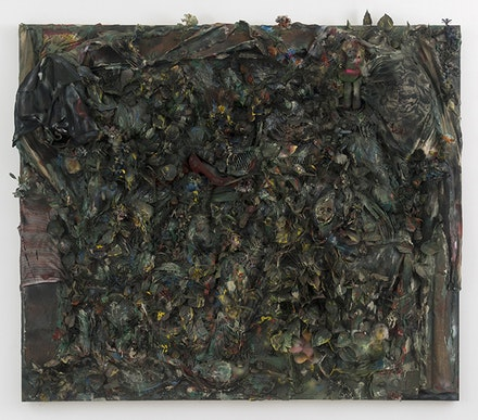 Thornton Dial, <em>The Color of Money: The Jungle of Justice</em>, 1996. Fabric, shoe, gloves, jigsaw puzzle pieces, artificial flowers and plants, dolls, stuffed animals, rope carpet, toys, cotton, found metal, other found materials, oil, enamel, spray paint, industrial sealing compound, on canvas mounted on wood. 77 x 86 x 12 inches. Courtesy David Lewis, New York. © Estate of Thornton Dial. Collection of the Souls Grown Deep Foundation.