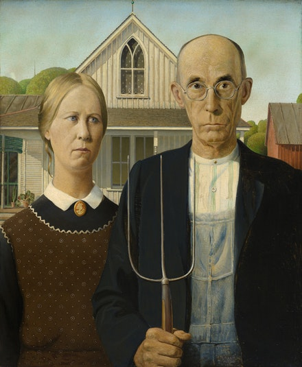 Grant Wood, <em>American Gothic,</em> 1930. Oil on composition board, 30 3⁄4 x 25 3⁄4 inches. © Figge Art Museum, successors to the Estate of Nan Wood Graham/Licensed by VAGA, New York, NY. Courtesy Art Institute of Chicago/Art Resource, NY