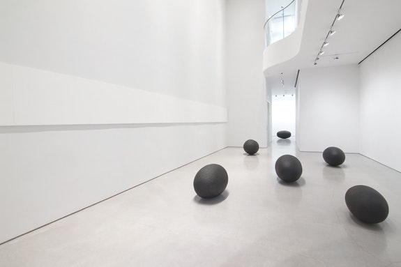 Wolfgang Laib, <em>Brahmanda</em> (installation view), 2016. Black granite, sunflower oil, and black smoke. Courtesy the Artist and Sperone Westwater, New York.