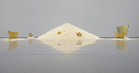 Wolfgang Laib, <em>Passageway</em>, 2013. 7 brass ships, rice, 18 x 128 x 102 inches. Courtesy the Artist and Sperone Westwater, New York