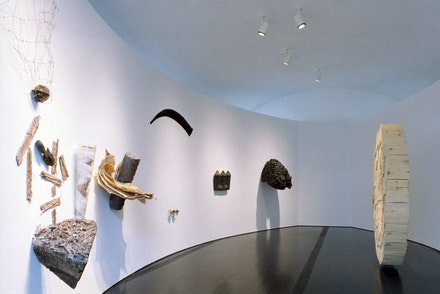 Mel Chin, <em>Operation of the Sun through the Cult of the Hand</em> (installation view), 1987. Mixed media forming 9 planets, 40 x 16 feet. Courtesy the Queens Museum. Photo: Hai Zhang.