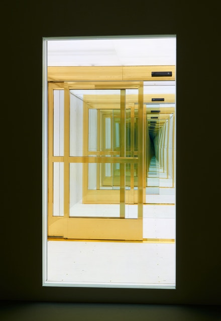 Sean Shim-Boyle, <em>Fee Fi Fo Fum</em>, 2018. Gold-wrapped motion-activated doors and two-way mirror. Courtesy Jane Lombard Gallery.