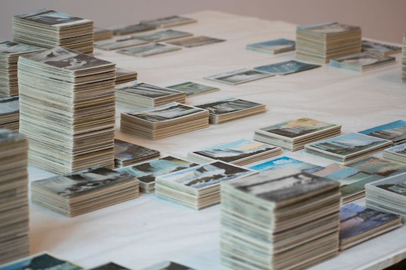Zoe Leonard, <em>Survey</em> (detail), 2009 – 2012. 6,266 postcards and table, dimensions variable. Collection Enea Righi, Bologna, and Galleria Raffaella Cortese, Milan. Photo: Louis Block.