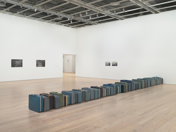 Installation view of <em>Zoe Leonard: Survey</em>, Whitney Museum of American Art. From left to right, back to front: <em>Model of New York</em>, 1989/1990; <em>Model of New York no. 2</em>, 1989/1990; <em>Water no. 1</em> +<em> Water no. 2</em>, 1988; 1961, 2002– . © Zoe Leonard. Photo: Ron Amstutz.
