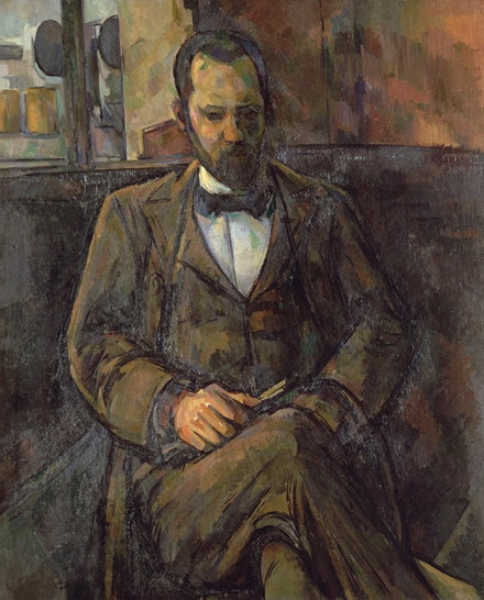 Paul Cézanne, <em>Ambroise Vollard</em>, 1899. Oil on canvas, 39 3/4 x 31 7/8 inches. Petit Palais, Musée des Beaux-Arts de la Ville de Paris. Photo: © RMN-Grand Palais (Musée d'Orsay) / Agence Bulloz.