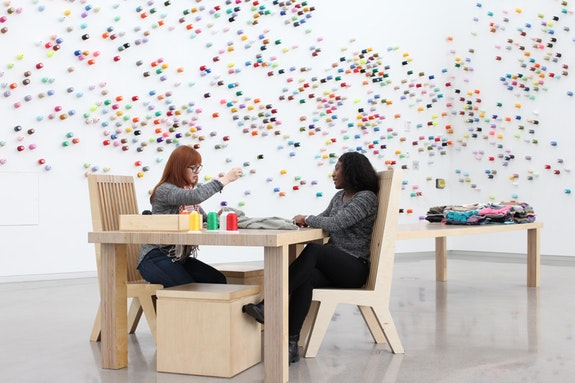 <p>Lee Mingwei, <em>The Mending Project, </em>2018. The Institute for Contemporary Art, Virginia Commonwealth University. Pictured (L to R): ICA staff member Caroline Legros and VCU student Natural Lyons participate. Photo: Rob Carter.</p>