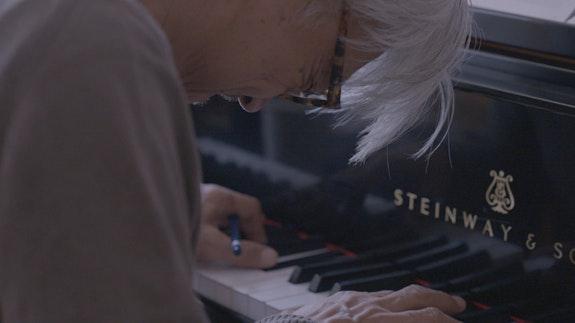 Ryuichi Sakamoto in <em>Ryuichi Sakamoto: Coda</em> by Stephen Nomura Schible, 2018. Photo: SKMTDOC, LLC. Courtesy of MUBI.
