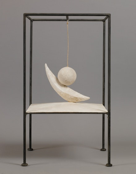 Alberto Giacometti, <em>Suspended Ball (Boule suspendue)</em>, 1930‐31. Plaster, painted metal, and string, 60.6 x 35.6 x 36.1 cm. Fondation Giacometti, Paris. © Alberto Giacometti Estate, Licensed by VAGA and ARS, New York.