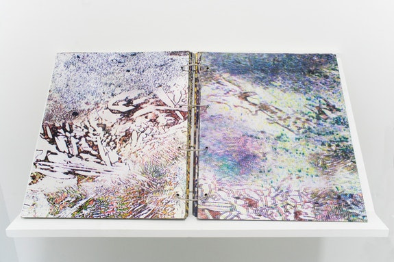 Antonia Kuo, <em>Untitled</em>, 2018. Artist book, UV-printed micrographs of metal on chipboard. 17 x 28 3/4 x 2 inches. Courtesy Rubber Factory.