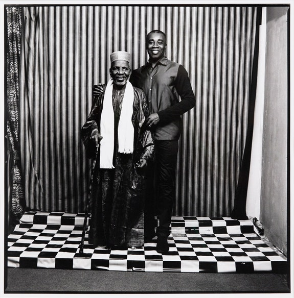 Malick Sidibé, <em>Untitled (Chris Ofili)</em>, 2014. Gelatin silver print, 18 X 17 7/8 inches. Courtesy Jack Shainman.