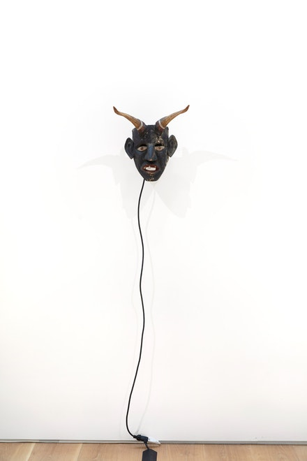 Raul Guerrero, <em>The Rotating Yaqui Mask</em>, 1973. Ritual mask, motor with foot pedal, 18 x 20 x 15 inches. ©Raul Guerrero, courtesy of Ortuzar Projects, New York.