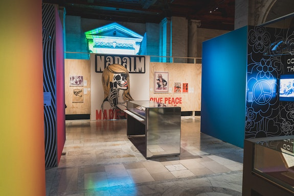 Installation shot of <em>You Say You Want A Revolution: Remembering the 60s</em>. Courtesy the NYPL.