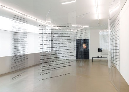 Martha Rosler, <em>Reading Hannah Arendt (Politically, for an American in the 21st Century)</em>, 2006. Installation with 16 transparent curtains with printed text, aluminum mounts. Courtesy Kunstmuseum Basel.