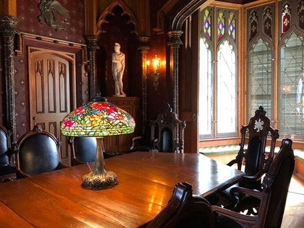 <p>Tiffany Studios, Peony library lamp, c. 1905, in the Dining Room at Lyndhurst. Leaded glass, bronze, 31 1/2 x 22 inches. The Neustadt Collection of Tiffany Glass, Queens, NY. Photo: &copy; Jason Rosenfeld.</p>