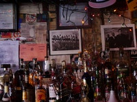 Behind the bar at Hank's Saloon, 2017. Featuring <em>Lunch Atop a Skyscraper</em>, 1932. Photo by the author.