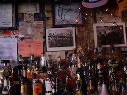 Behind the bar at Hank&rsquo;s Saloon, 2017. Featuring <em>Lunch Atop a Skyscraper</em>, 1932. Photo by the author.