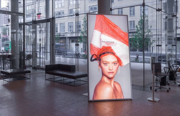 Installation view of Eckhaus Latta: <em>Possessed</em>, Whitney Museum of American Art, New York, 2018. Lightbox photo: Charlotte Wales; Art direction: Eric Wrenn; Modeling: Gemma Ward for IMG; Styling: Avena Venus Gallagher; Hair: Shingo; Makeup: Kanako Takase; Production: Blake Abbie, Spencer Morgan Taylor, and Carlos Garcia of Harbinger Creative; Retouch: studioRM. Photo: Jason Mandella.