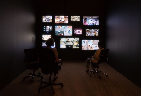 Installation view, Eckhaus Latta: <em>Possessed</em>, Whitney Museum of American Art, New York, 2018). Surveillance footage on monitors: Film by Alexa Karolinski; Edited by Mary Clark. Surveillance footage locations: Eckhaus Latta, Los Angeles, CA; Galeries Lafayette, Paris, France; LN-CC, London, United Kingdom; Maryam Nassir Zadeh, New York, NY; Neighbor, Vancouver, Canada; Opening Ceremony, New York, NY; Robin Richman, Chicago, IL; Stand Up Comedy, Portland, OR; Tenoversix, Dallas, TX; The Four Eyed, Tokyo, Japan; The Store, Berlin, Germany; Totokaelo, New York, NY; SSENSE, Montreal, Canada. Photo: Jason Mandella.