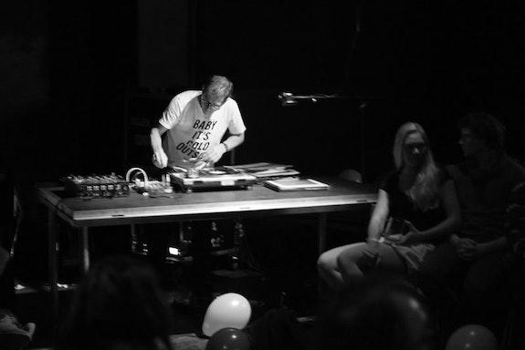The artist performing<em> 33⅓ RPM </em>at Kabinet Múz, Brno, Czech Republic 2017. Image courtesy the artist.