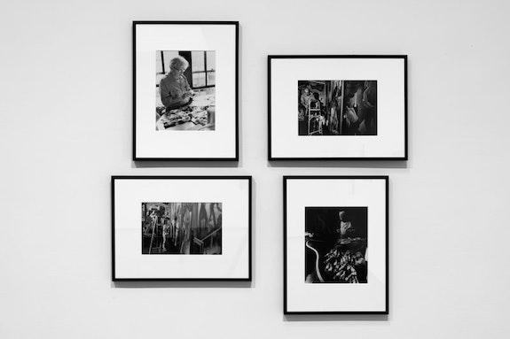 Installation view, <em>Peter Moore: 1968</em>, Paula Cooper Gallery, New York, 2018. Photo: Steven Probert.  The photographs show Thomas Hart Benton restoring <em>America Today</em> at The New School, September 11, 1968.