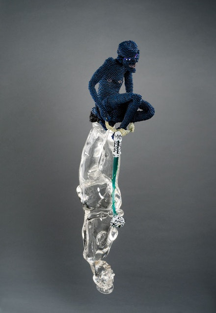 oyce J. Scott, <em>Water Mammy 1</em>, 2012. Blown glass, beads, thread, wire, repurposed beaded shapes, 35 x 6 1/2 x 10 inches. Courtesy Goya Contemporary Gallery, Baltimore. © Joyce J. Scott and Goya Contemporary Gallery.
