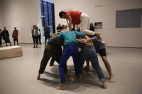 Simone Forti. <em>Huddle</em>. 1961. Performance. Committee on Media and Performance Art Funds. Performed in <em>Judson Dance Theater: The Work Is Never Done</em>, The Museum of Modern Art, New York, September 16, 2018–February 3, 2019. Performers: Martita Abril (top), Vanessa Vargas, Alexis Ruiseco-Lombera, Lindsay Londs Reuter, Samuel Hanson, Christiana Cefalu, Elizabeth Hart, Laura Pfeffer, Miguel Ángel Guzmán. Digital image © 2018 The Museum of Modern Art, New York. Photo: Paula Court.
